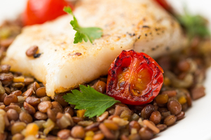 Lentils and cod with braised tomatoes and bacon