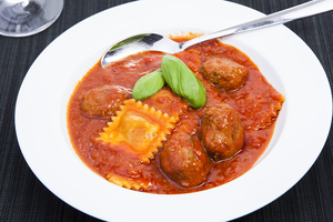 Slow cooked ragu and cheese ravioli with meatballs