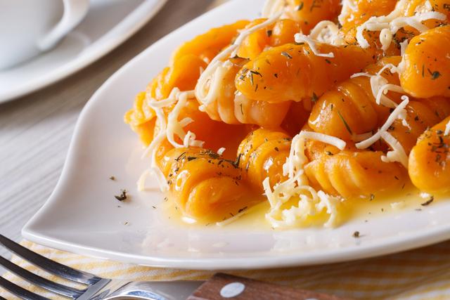 Pumpkin gnocchi with pancetta and herb sauce