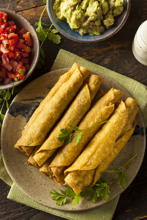 Taquitos with tomato salsa