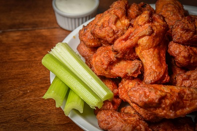 Spicy wings with blue cheese dip