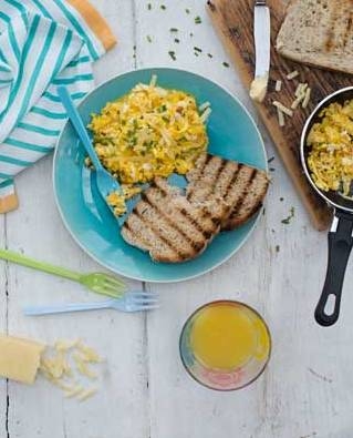 Scrambled eggs with onion and cheddar cheese